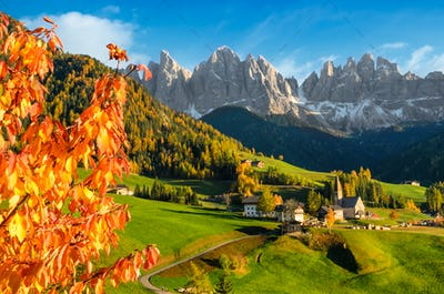 Village in a Dolomite landscape in autumn