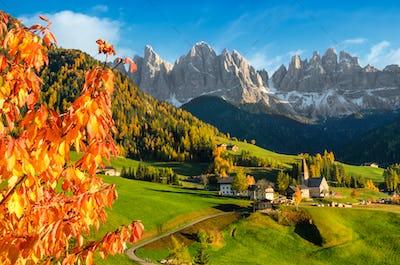 Village in a Dolomite landscape in autumn