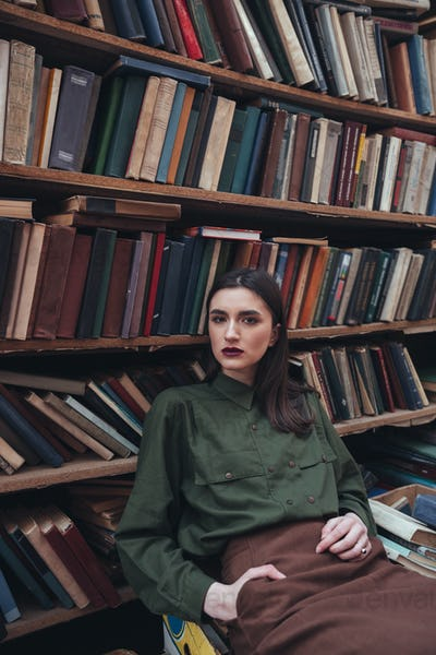 Portrait of girl in library looking camera