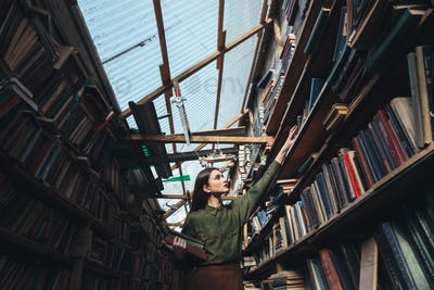 Horizontal image of girl in library