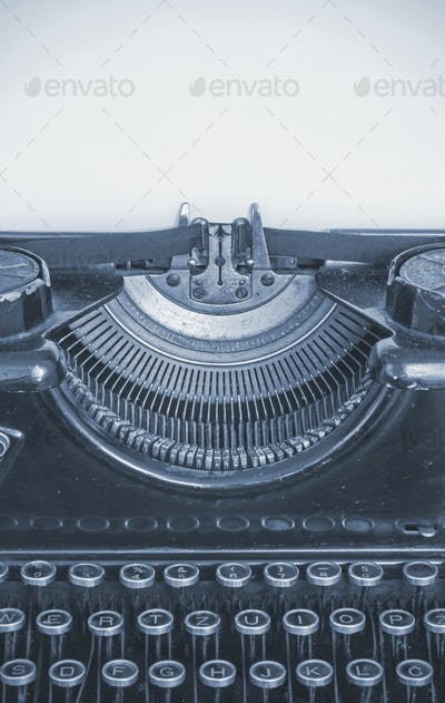 Old typing machine and blank sheet of paper for your text, cyano style