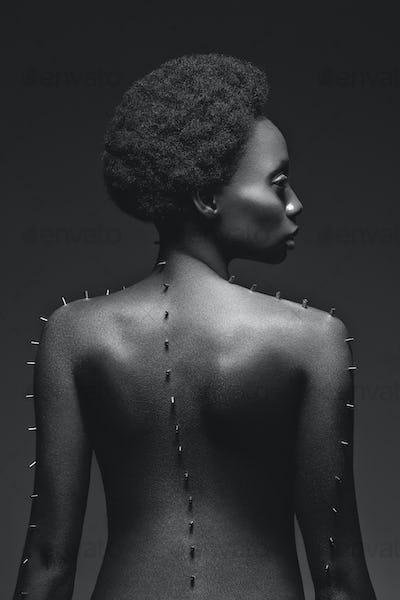 Beautiful black girl with metal pins