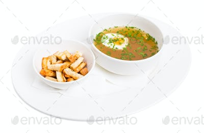 Chicken bouillon with egg and crumbs.