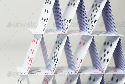 house of playing cards over white background