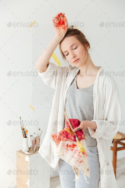 Attractive young caucasian lady painter
