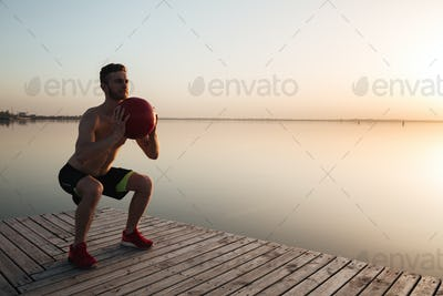 Handsome young sportsman make sport exercises