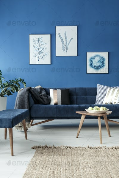 Sofa and end table in blue room