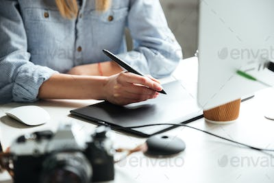 Cropped image of young woman work in office