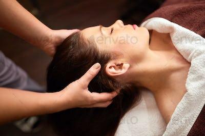woman having head massage at spa