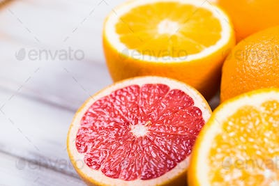 Fresh citrus fruits on a brown wooden table