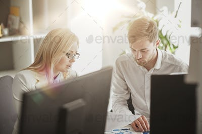 business team discussing papers at office table