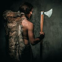 Furious viking with cold weapon