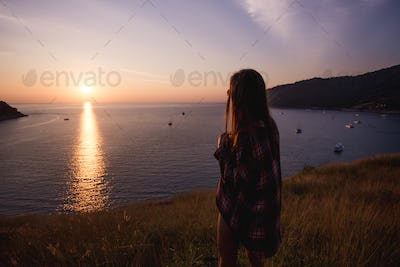 young freedom woman enjoy ocean sunset on mountain peak