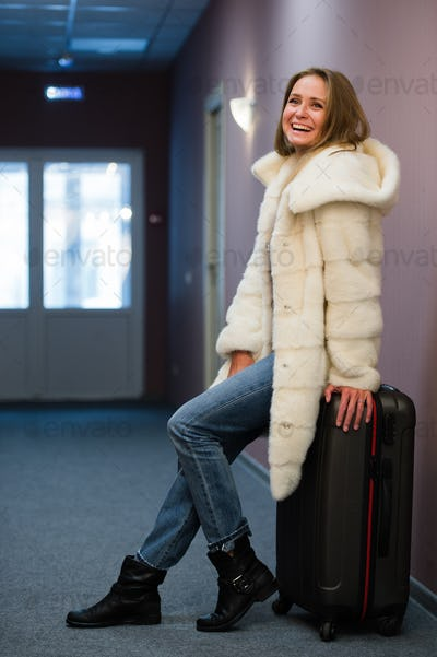 Young woman waiting for a journey.