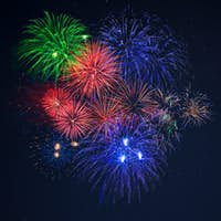 Beautiful blue green red celebration fireworks copy space