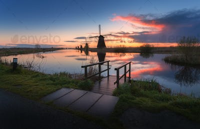 Silhouette of windmills at sunrise in Kinderdijk, Netherlands