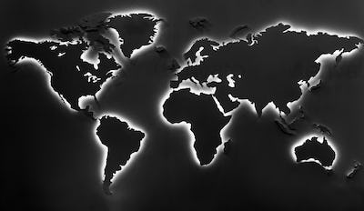 Illuminated earth map on black background