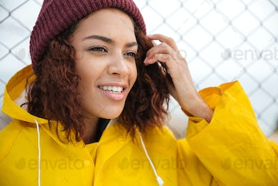 Concentrated african young lady walking outdoors