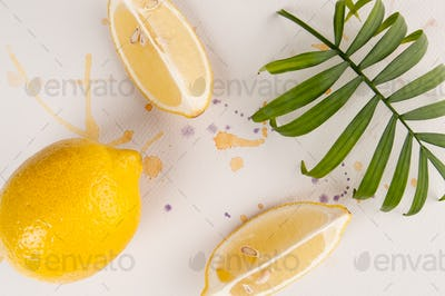 Lemons are on white watercolor paper with multi-colored spray pa