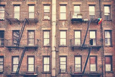 Building with fire escape, one of New York City symbols, USA.