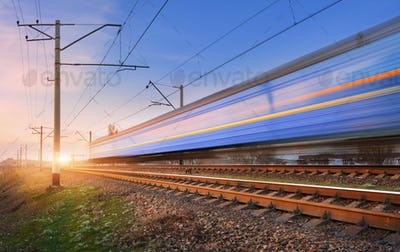 High speed passenger train in motion on railroad