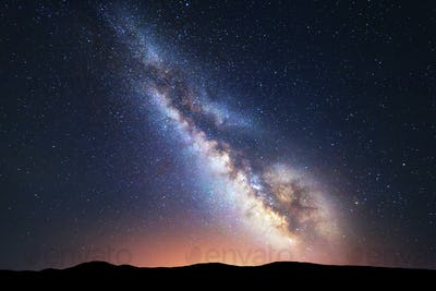 Fantastic night landscape with bright milky way