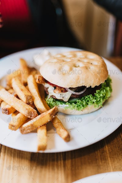 Delicious hamburger with fries