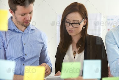 Executives Discussing In Office Seen Through Glass