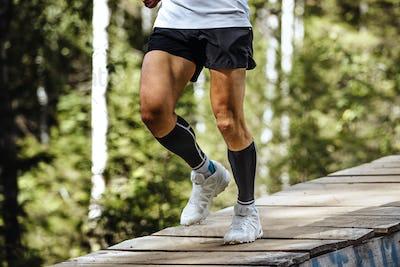 Marathon Runner Running in Forest