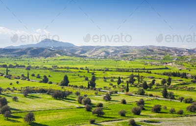 View of beautiful landscape with fresh green meadows and mountain tops