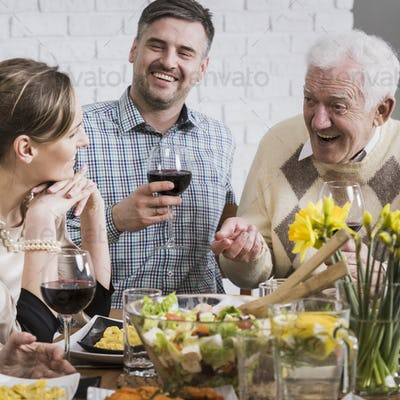 Happy family sitting beside table