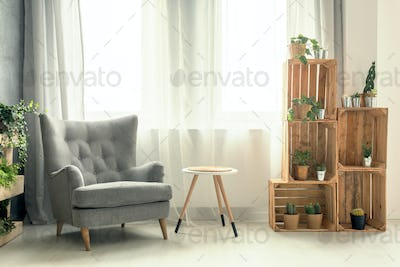 Living room with armchair and DIY shelf