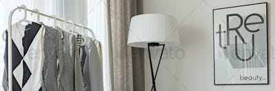 Clothes, lamp and poster