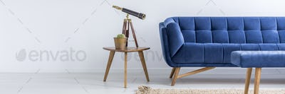 Sofa and table with telescope