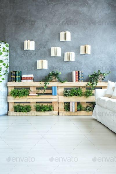 Bookshelf made of pallets in room