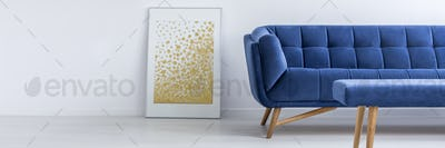 Poster, sofa and table