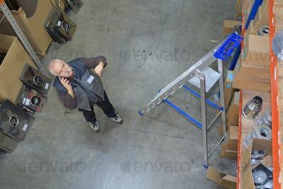 Downward view of man in storeroom