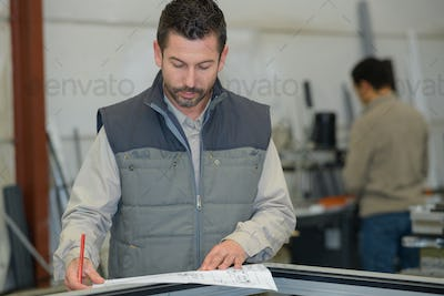 engineer working at construction site with blueprint