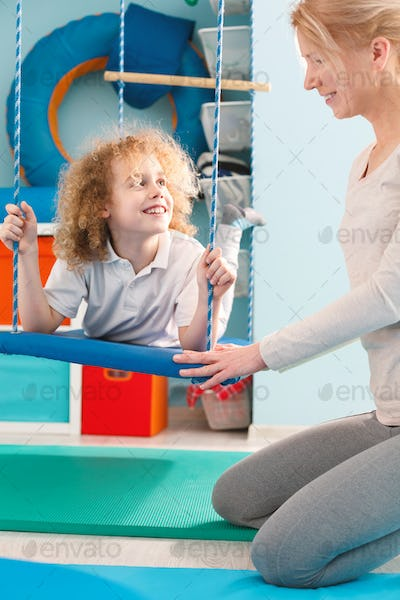 Boy using therapy swing