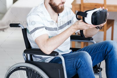 Disabled man with VR goggles