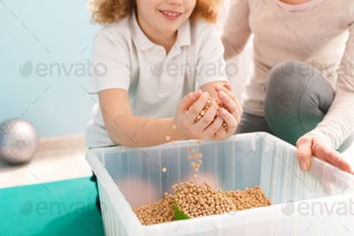 Boy playing with chickpeas