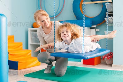 Boy on therapy swing