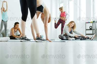 Women stretching after training