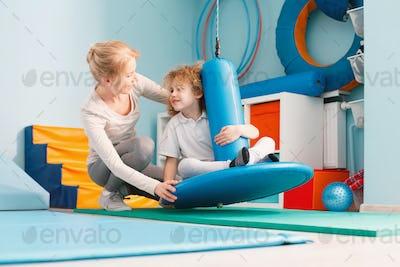 Boy using sensory integration equipment