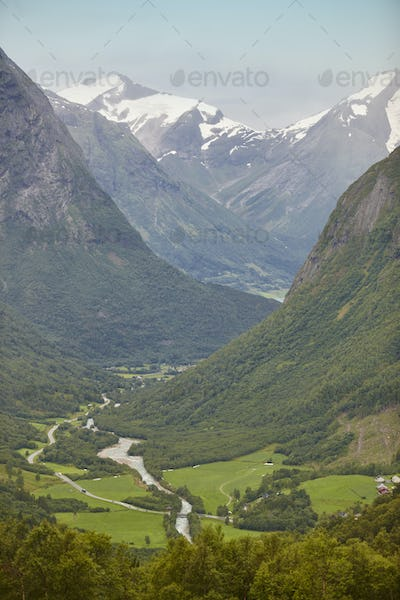 Norwegian mountain landscape with valley river and snow. Scenery