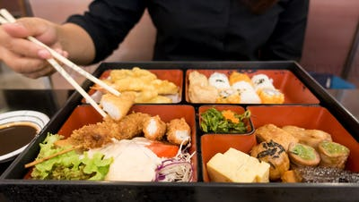 women eating  bento box set