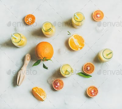 Healthy yellow smoothie with citrus fruit, ginger and ice