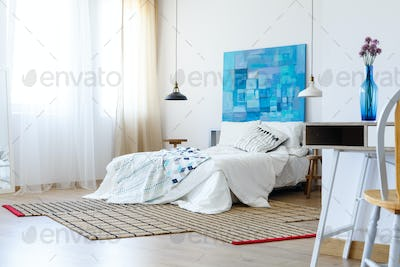 Bedroom with colorful artwork