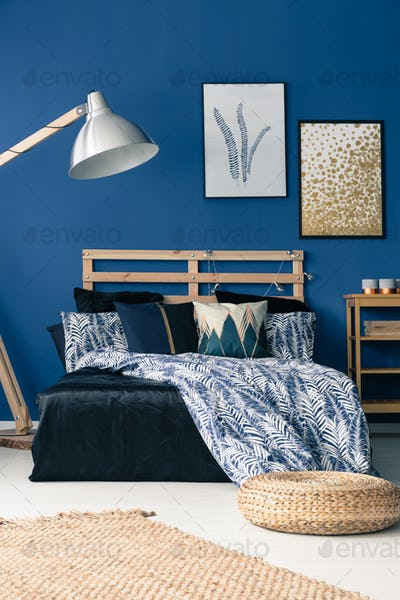 Bedroom with cyan wall