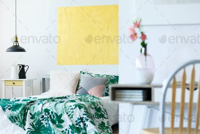Pastel bedroom with artworks